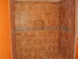 tiled shower walls with built in shelve