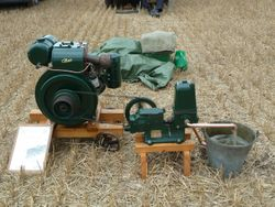 A stationary engine driving a pump