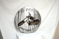 Custom Saw Art with His bike made into a metal art