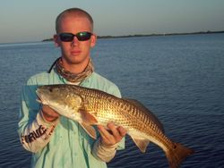 "nathan with a 27"" redfish."
