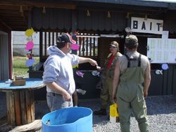 Fishermen getting their fish checked in for prizes