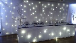Whit starlight backdrop curtain and top table package hire