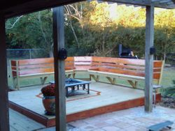 treated deck with sinker cypress back rests and bottom band