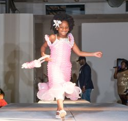 Love her sweet little smile! She had so much energy on the runway- Lots of talent for her age!!