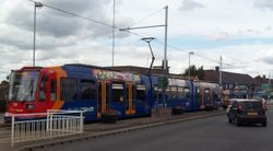 Supertram 124 pausing at Manor Top