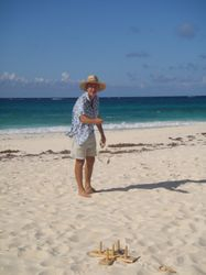 Playing quoits on the beach on Great Guana Cay