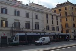 An unidentified Fiat II tram decending the incline which is Piazza del Colosseo.