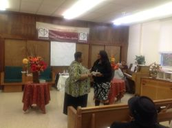 Pastor Chris presenting Elder Tenisha Watson with Donation