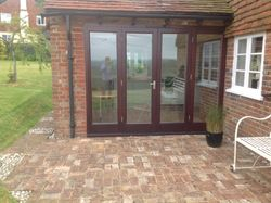 Brick built patio. Side elevation showing bi-folding patio doors