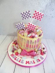 Pink and purple checkered flag drip cake