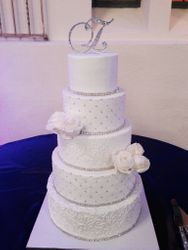 All white wedding cake with damask and piped scrolls