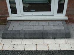 Step build with key kerbs & cobble paving