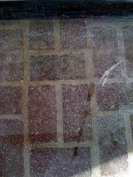 Inside brick floor before cleaning