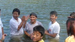 Motilal Magar being Baptized