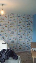 Bob the Builder wallpaper in a children's nursery.
