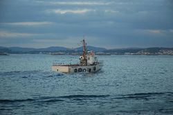 The Pobra festival - the boat carries the wreath out to sea