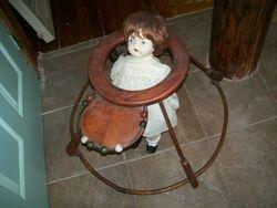 very old, primitive, antique baby stroller