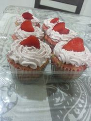 Marbled pink and white Vanilla Cupcakes soaked in strawberry syrup-citrus cream cheese frosting
