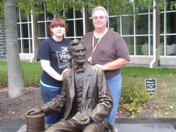 Outside Visitor Center with Abe