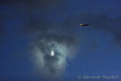 Plane with the Moon