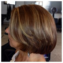 A warm base color with highlights, cut & style