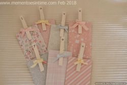 Decorated pegs and money wallet notelets