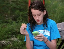 Mallory eats a S'mores and checks her messages