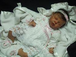 In her pretty crocheted dress