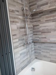 Tiled master bathroom.