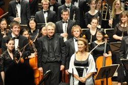 Receiving the applause after the performance of Mahler Symphony No. 3 with the McGill Symphony Orchestra Montreal and contralto soloist Annamaria Popescu