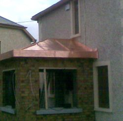 Porch Copper hip with seceret gutter Kimage