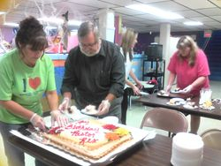 He even helped serve his cake!