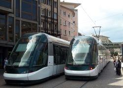 Alstom Citadis trams, with Place de 'Homme de Fer in the background.