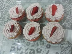 Pink and White Marbled Cupcakes with Fresh Strawberries and Cream Frosting