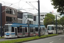 Duewag Low Floor and M-Type trams passing along Poststrasse.
