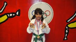 Frida Acosta 1st place fighting 1st in forms 1st in breaking