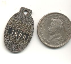 Reverse side badge and two shilling piece