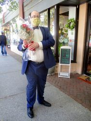 Alec Frazier with Bouquet of Flowers for Lying in Repose of Associate Supreme Court Justice Ruth Bader Ginsburg Outside Park Florist