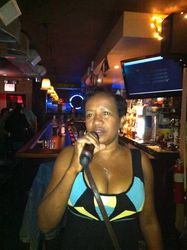 Bridget expressing herself at 502 Bar Lounge's Social Saturday Night Karaoke.