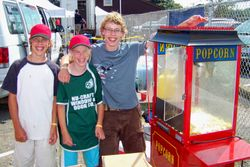 Lucas, Rachel and Raymond helping at the popcorn machine