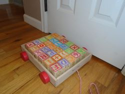 Uncle Goose Classic ABC Blocks with Melissa & Doug Pull Wagon - $10
