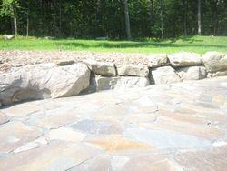 flagstone patio/boulder wall