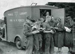 soldiers reading books outside mobile library