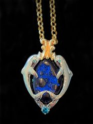 One of a kind agate dolphin pendant with blue diamonds