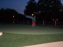 Sterling & Michael playing night glow putt putt