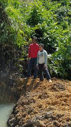Farmers at their newly dug fishpond