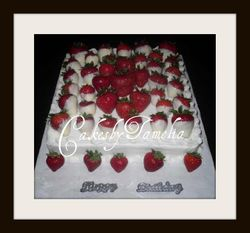 white cake with strawberries