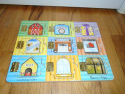 Melissa & Doug Hide and Seek Wooden Activity Board - $5