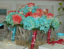 Blue Hydrangea and Coral Rose Bouquets