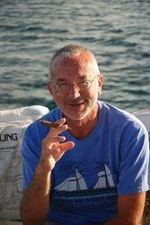John smoking a Cuban cigar